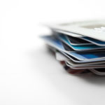 color photo of a stack of credit cards. Shallow depth of field.