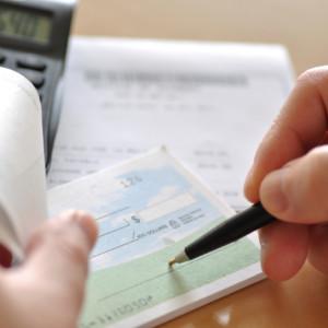 Business man writing check